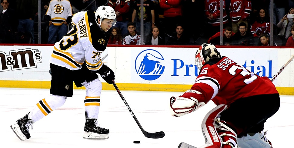 Charlie McAvoy scores the game-winning goal in a shootout against Cory Schneider of the New Jersey Devils on Nov. 22, 2017. (Photo by Elsa/Getty Images)