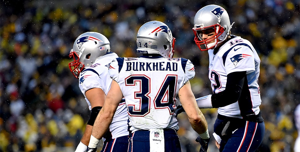 Rex Burkhead celebrates with Tom Brady after rushing for a one-yard touchdown against the Pittsburgh Steelers. (Photo by Joe Sargent/Getty Images)