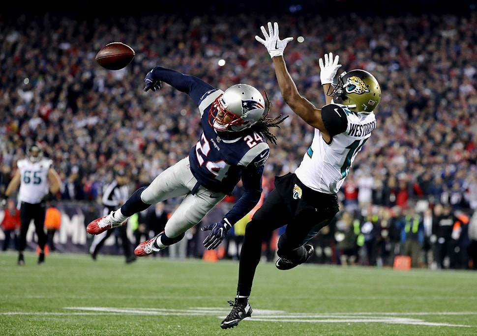 Stephon Gilmore deflects a pass intended for Dede Westbrook of the Jacksonville Jaguars in the fourth quarter during the AFC Championship Game at Gillette Stadium on January 21, 2018 in Foxborough, Massachusetts. (Photo by Elsa/Getty Images)