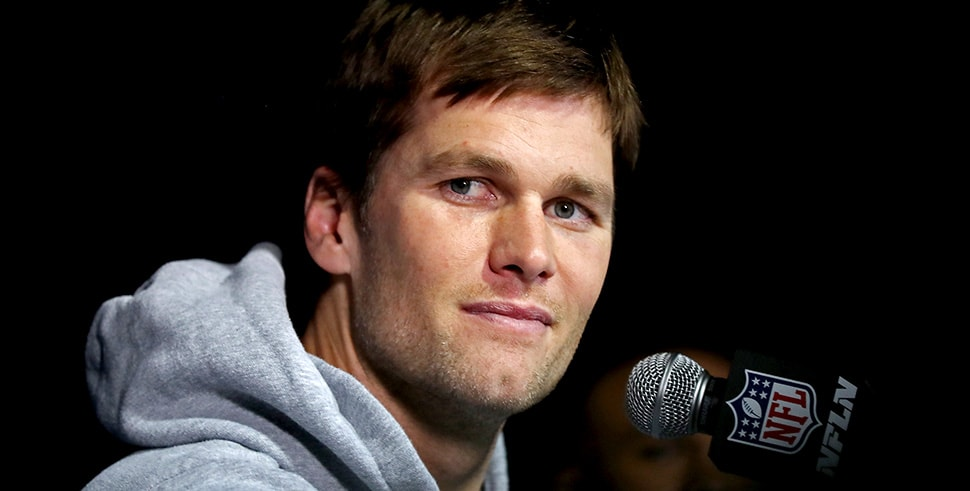 Tom Brady of the New England Patriots answers questions during the New England Patriots' Media Availability for Super Bowl LII. (Photo by Elsa/Getty Images)