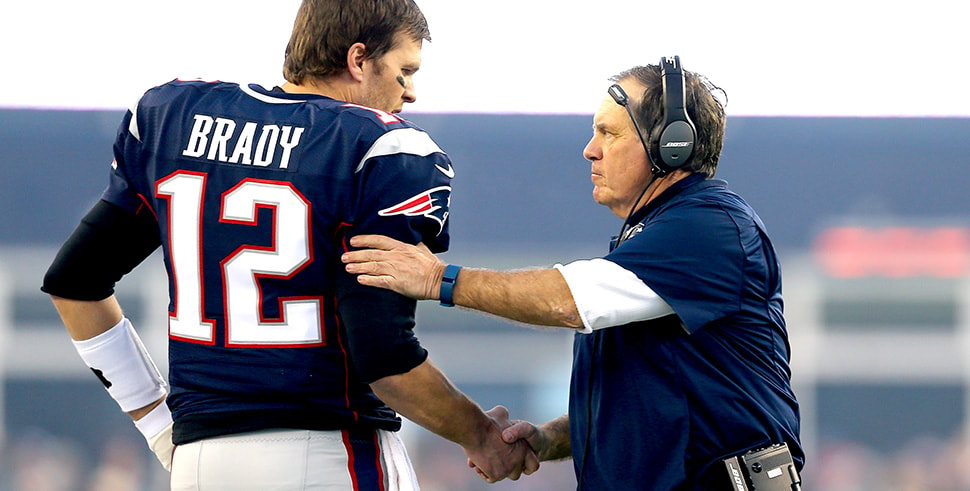 Tom Brady and Bill Belichick of the New England Patriots shake hands at the start of the AFC Divisional Playoff Game against the Kansas City Chiefs at Gillette Stadium on Jan. 16, 2016. (Photo by Maddie Meyer/Getty Images)