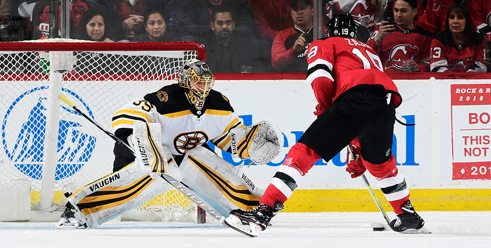 Anton Khudobin stops a first-period penalty shot from Travis Zajac of the New Jersey Devils at Prudential Center on Feb. 11, 2018 in Newark, New Jersey. (Photo by Steven Ryan/Getty Images)