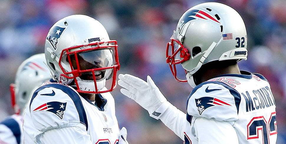 (L-R) Malcolm Butler, Devin McCourty (Photo by Tom Szczerbowski/Getty Images)