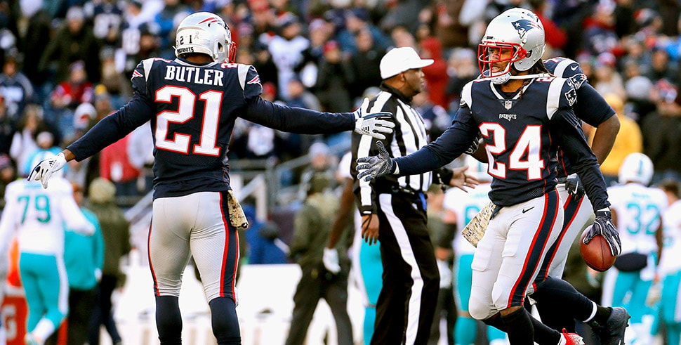 Stephon Gilmore reacts with Malcolm Butler after intercepting a pass during a game against the Miami Dolphins at Gillette Stadium on November 26, 2017. (Photo by Jim Rogash/Getty Images)