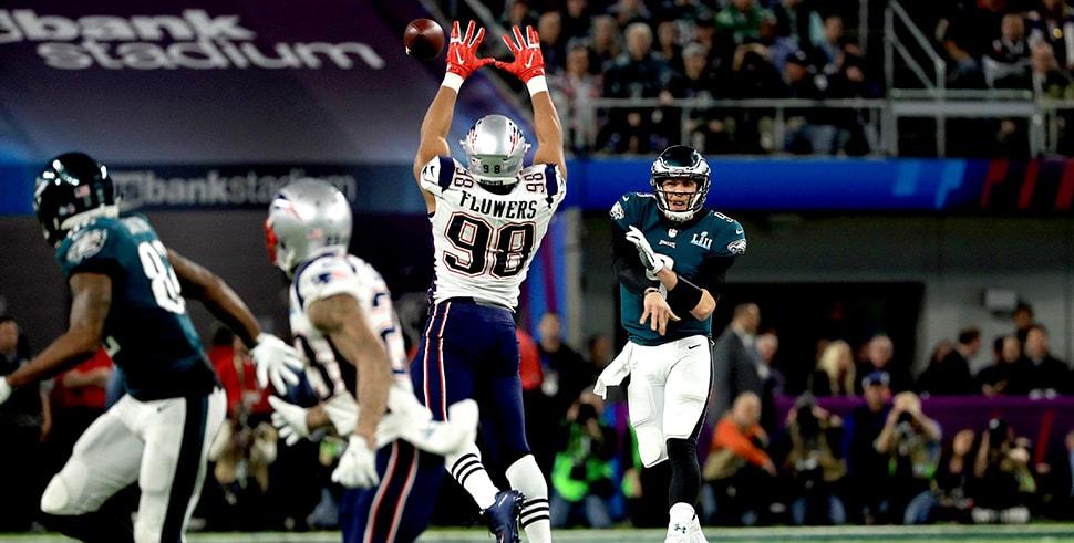 Nick Foles of the Philadelphia Eagles throws against Trey Flowers during Super Bowl LII. (Photo by Mike Ehrmann/Getty Images)