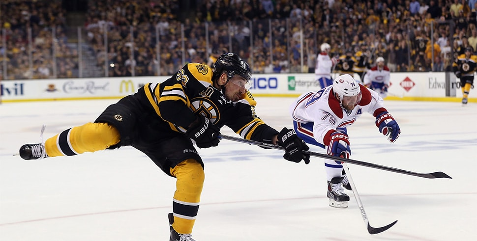 Brad Marchand shoots for the Boston Bruins against the Montreal Canadiens during Game 5 of the Second Round of the 2014 NHL Stanley Cup Playoffs. (Photo by Bruce Bennett/Getty Images)