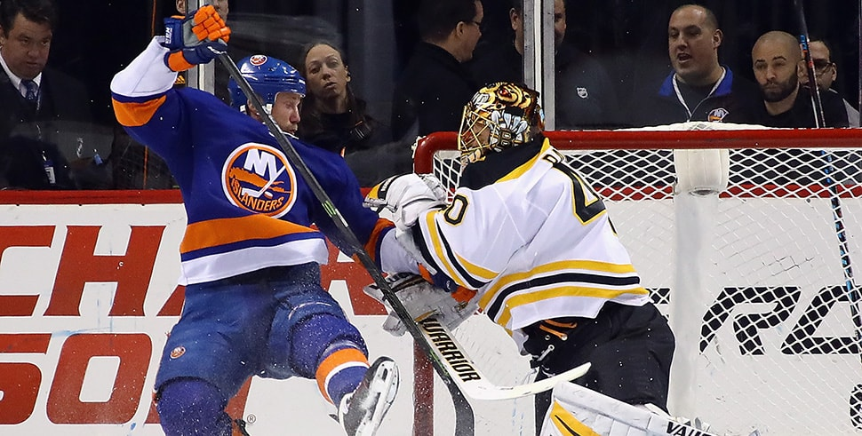 Jason Chimera of the New York Islanders gets tangled up with Tuukka Rask during the first period at the Barclays Center on January 2, 2018 in the Brooklyn borough of New York City. (Photo by Bruce Bennett/Getty Images)