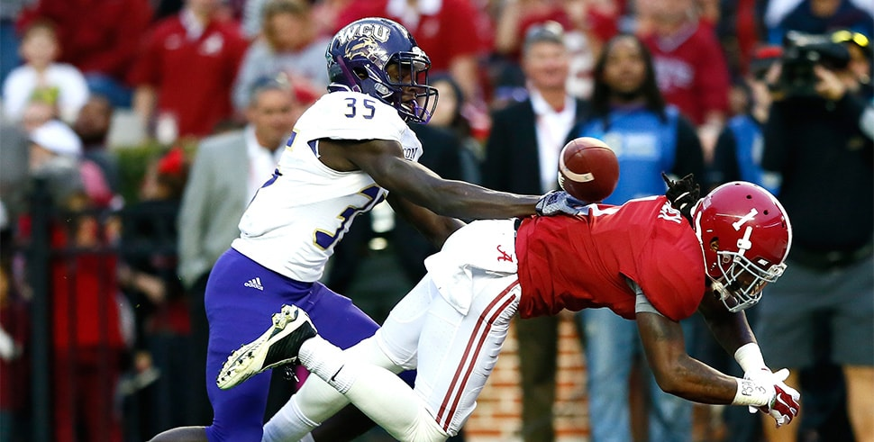 TUSCALOOSA, AL - NOVEMBER 22: Chris Black #1 of the Alabama Crimson Tide fails to pull in this touchdown reception against Keion Crossen #35 of the Western Carolina Catamounts at Bryant-Denny Stadium on November 22, 2014 in Tuscaloosa, Alabama. (Photo by Kevin C. Cox/Getty Images)