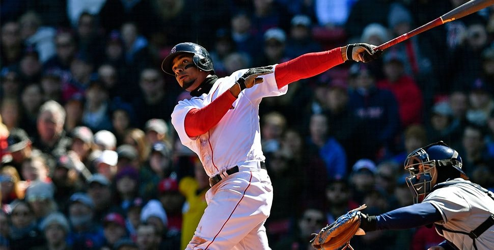 Apr 7, 2018; Boston, MA, USA; Boston Red Sox shortstop Xander Bogaerts (2) watches the ball after hitting a home run against the Tampa Bay Rays in the second inning at Fenway Park. Mandatory Credit: Brian Fluharty-USA TODAY Sports