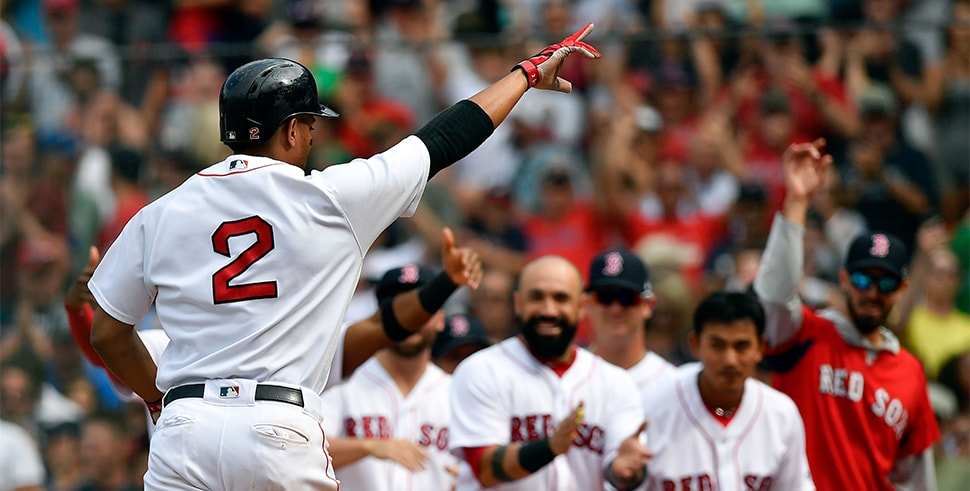 Jul 14, 2018; Boston, MA: Boston Red Sox shortstop Xander Bogaerts celebrates with teammates after hitting a walk off grand slam against the Toronto Blue Jays during the tenth inning at Fenway Park. (Photo Credit: Brian Fluharty-USA TODAY Sports)
