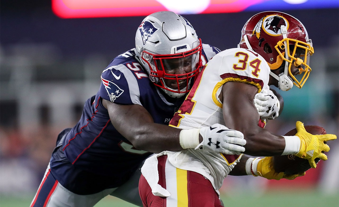 Aug 9, 2018; Foxborough, MA: New England Patriots linebacker Ja'Whaun Bentley tackles Washington Redskins running back Byron Marshall during the second quarter at Gillette Stadium. (Credit: Paul Rutherford-USA TODAY Sports)