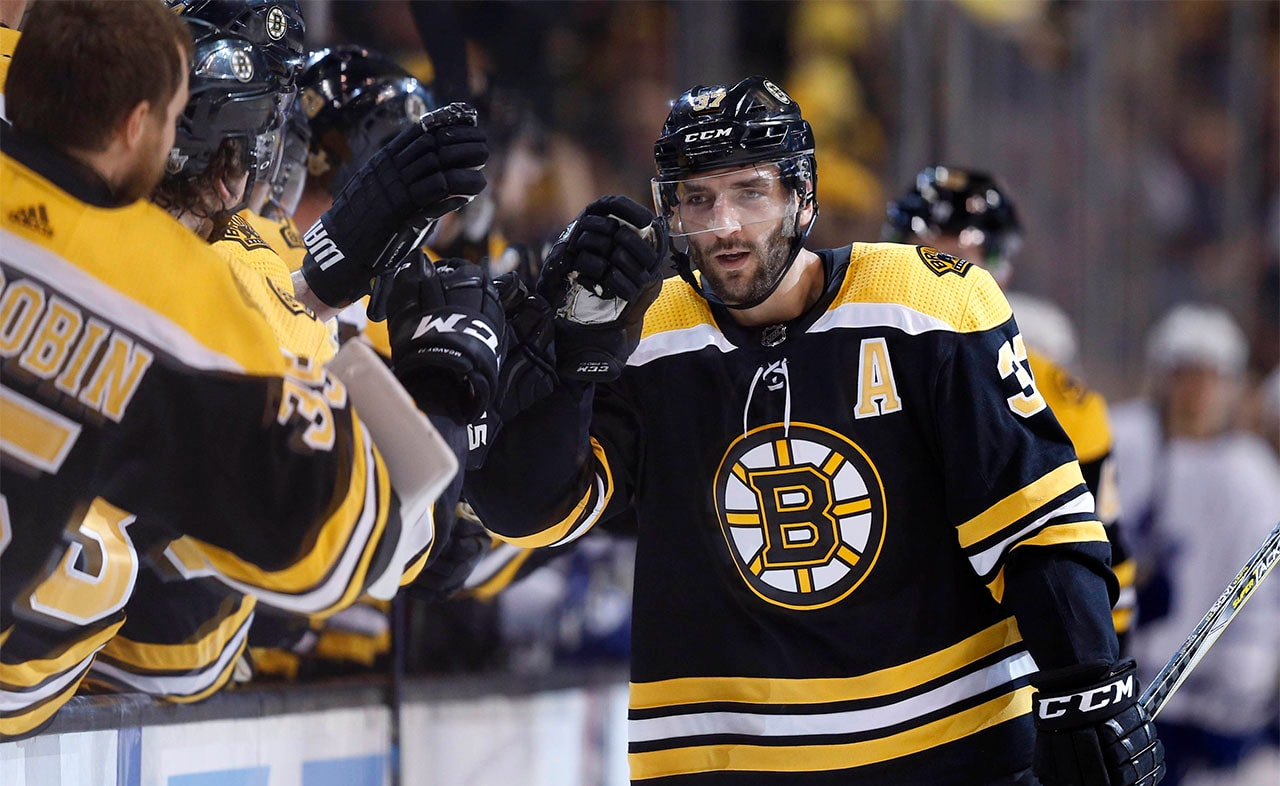 Apr 25, 2018, Boston, MA: Boston Bruins center Patrice Bergeron skates past the bench after scoring a goal during the first period against the Toronto Maple Leafs in game seven of the first round of the 2018 Stanley Cup Playoffs at TD Garden. (Credit: Greg M. Cooper-USA TODAY Sports)