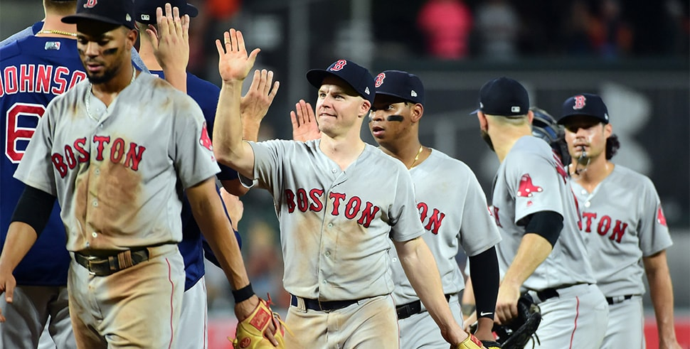 Aug 10, 2018; Baltimore, MD, USA; Boston Red Sox second baseman Brock Holt (12) high fives teammates after beating the Baltimore Orioles 19-12 at Oriole Park at Camden Yards. (Credit: Evan Habeeb-USA TODAY Sports)