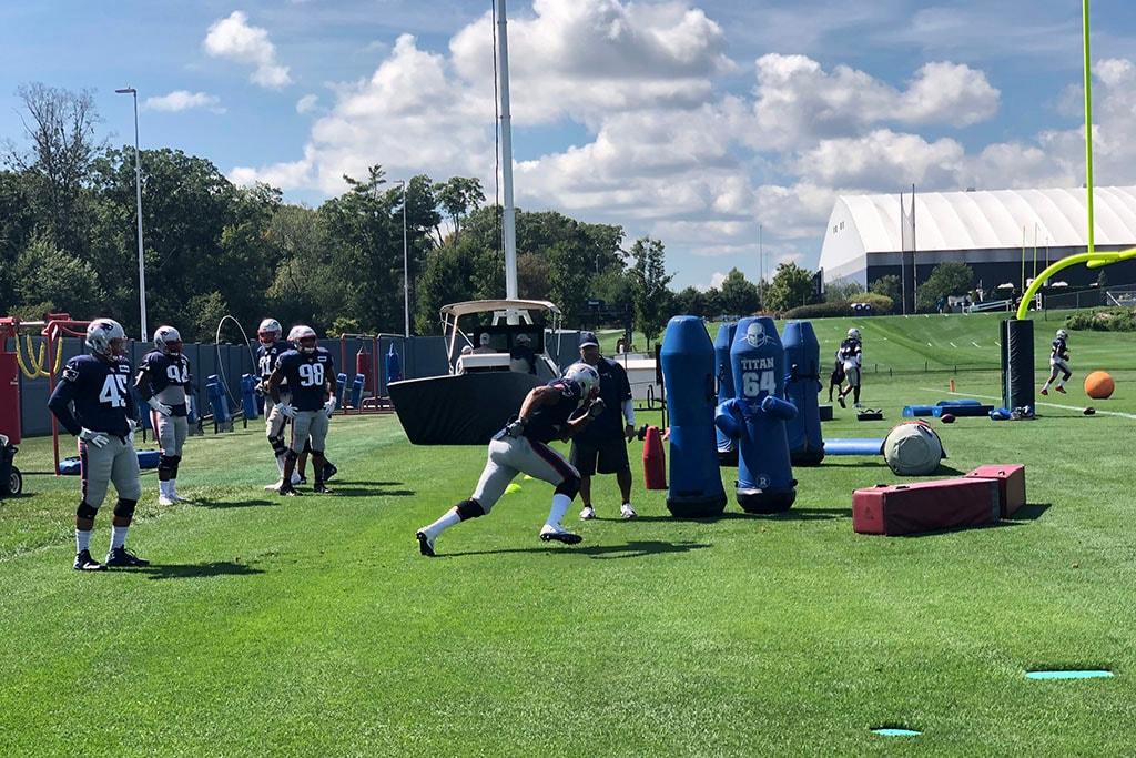 Patriots pass rush consultant Joe Kim works with edge rushers during practice on Sept. 5, 2018 in Foxborough, Mass. (Matt Dolloff/WBZ-FM)