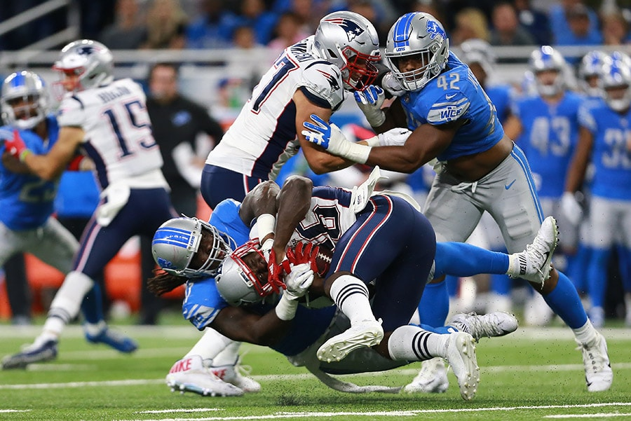 DETROIT, MI - SEPTEMBER 23, 2018: Ricky Jean Francois of the Detroit Lions makes a third down stop on Sony Michel of the New England Patriots during the second quarter at Ford Field. (Photo by Rey Del Rio/Getty Images)