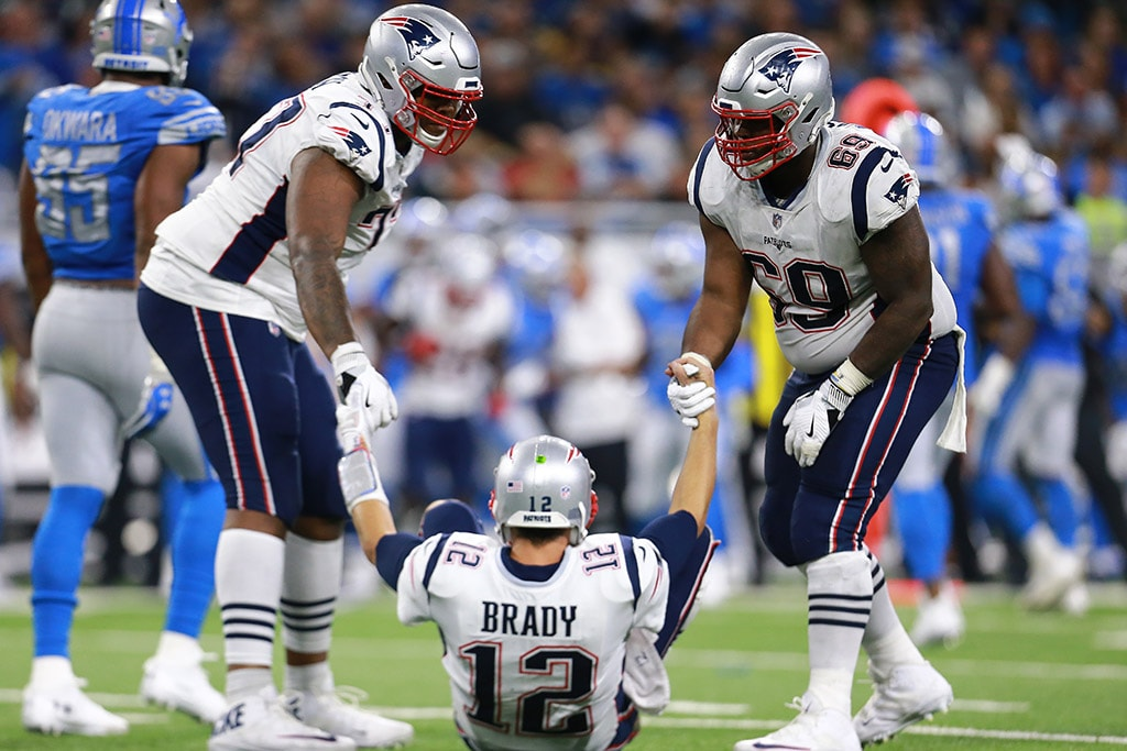 DETROIT, MI - SEPTEMBER 23: Trent Brown of the New England Patriots and Shaq Mason help their quarterback Tom Brady up off the field after a sack during the second half at Ford Field. (Photo by Rey Del Rio/Getty Images)