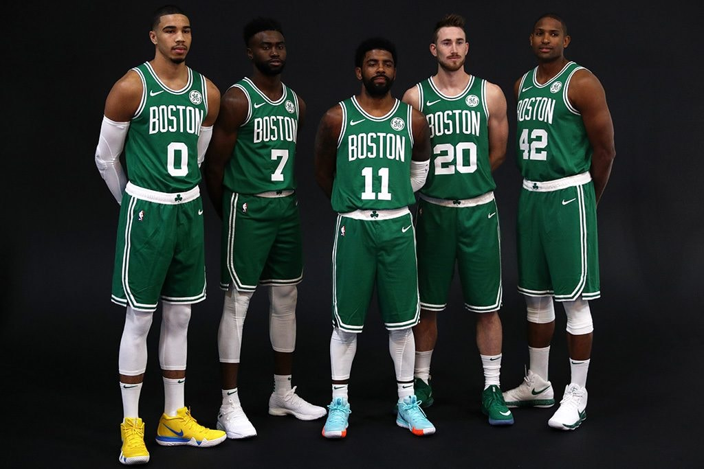 CANTON, MA - SEPTEMBER 24: From left Jayson Tatum, Jaylen Brown, Kyrie Irving, Gordon Hayward and Al Horford pose together for a photo during Boston Celtics Media Day on September 24, 2018 in Canton, Massachusetts. (Photo by Maddie Meyer/Getty Images)