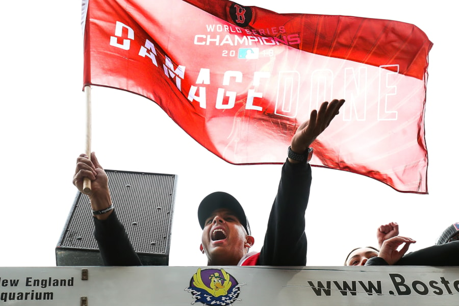 BOSTON, MA - OCTOBER 31:  Manager Alex Cora of the Boston Red Sox acknowledges fans during the 2018 World Series victory parade on October 31, 2018 in Boston, Massachusetts. (Photo by Adam Glanzman/Getty Images)