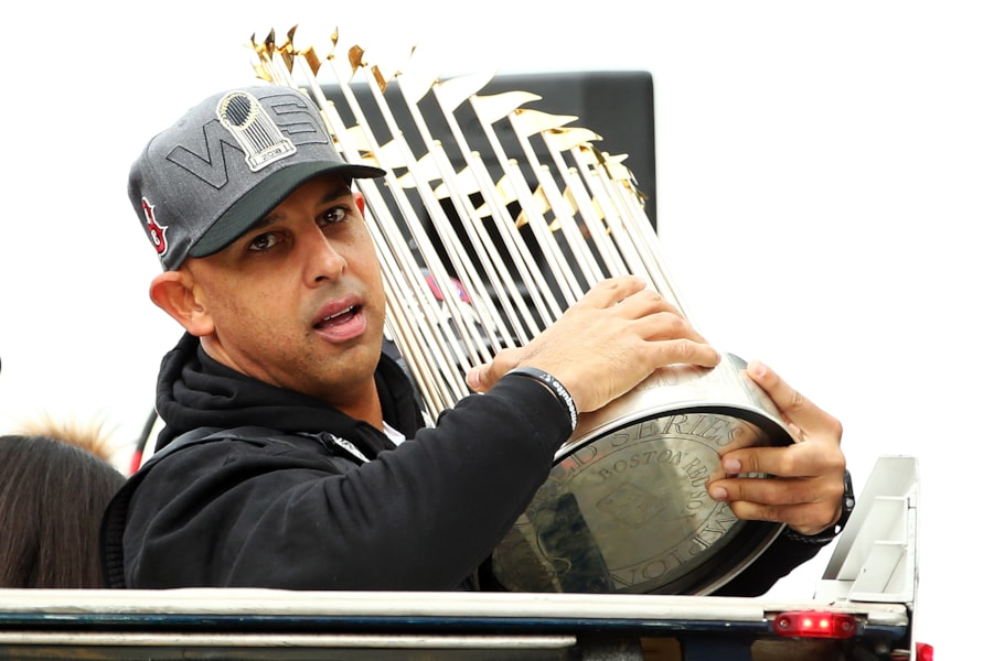 BOSTON, MA - OCTOBER 31:  Boston Red Sox Manager Alex Cora holds the World Series trophy during the 2018 World Series victory parade on October 31, 2018 in Boston, Massachusetts. (Photo by Adam Glanzman/Getty Images)