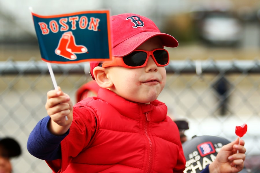 BOSTON, MA - OCTOBER 31:  A young fan cheers during the 2018 Boston Red Sox World Series victory parade on October 31, 2018 in Boston, Massachusetts. (Photo by Adam Glanzman/Getty Images)