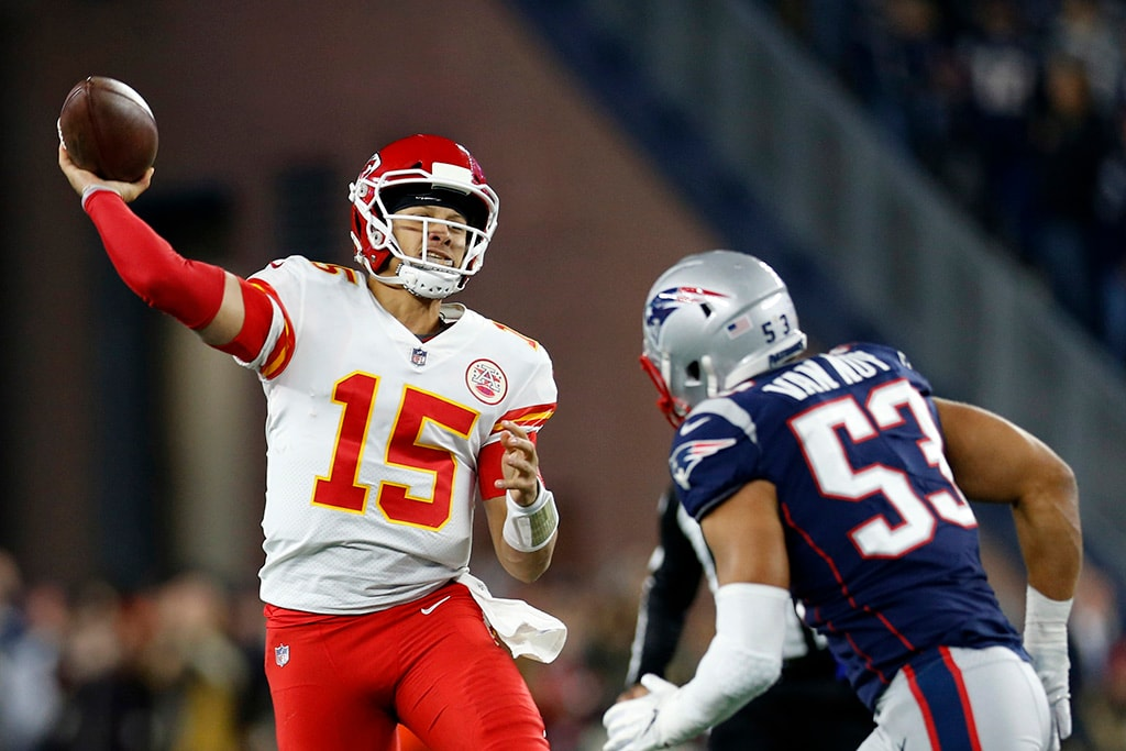 Oct 14, 2018; Foxborough, MA: Kansas City Chiefs quarterback Patrick Mahomes makes a pass while defended by New England Patriots linebacker Kyle Van Noy during the second quarter at Gillette Stadium. (Greg M. Cooper-USA TODAY Sports)