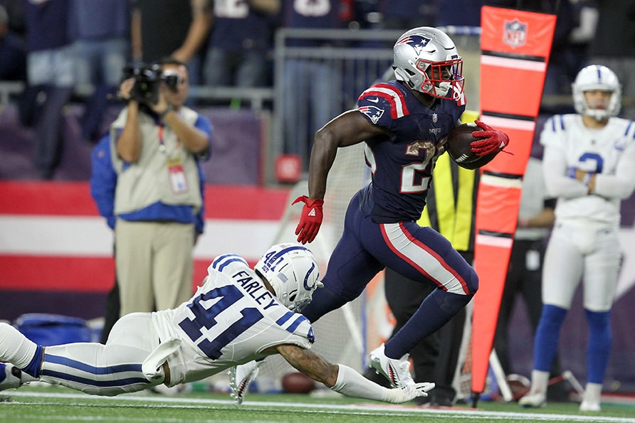 Oct 4, 2018; Foxborough, MA: New England Patriots running back Sony Michel avoids a tackle by Indianapolis Colts safety Matthias Farley on his way to score a touchdown during the fourth quarter at Gillette Stadium. (Stew Milne-USA TODAY Sports)
