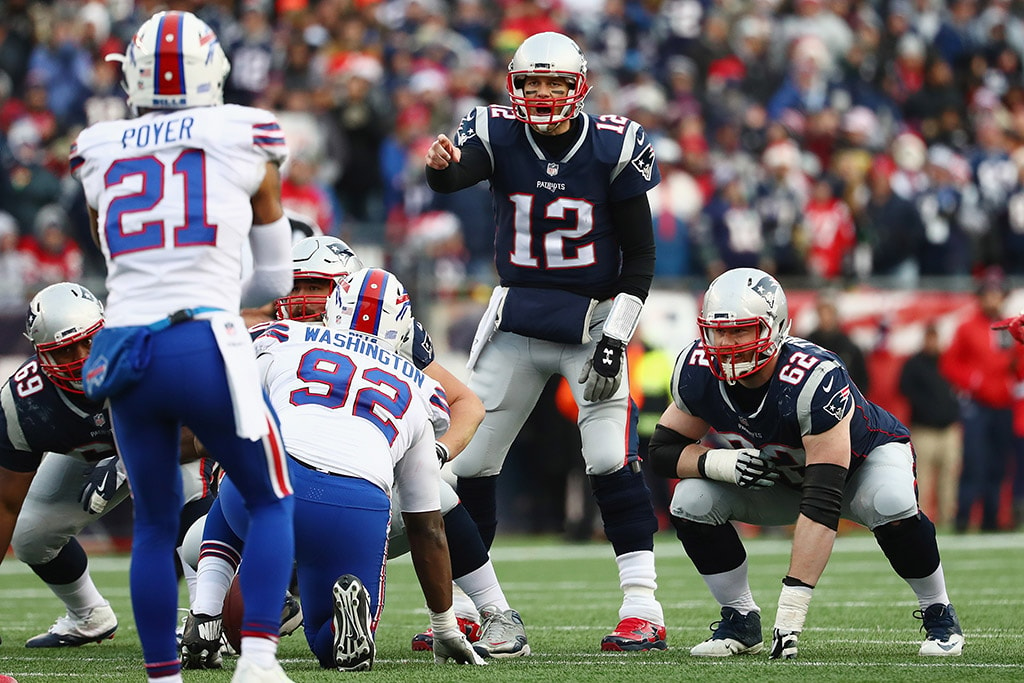 FOXBORO, MA - DECEMBER 24: Tom Brady of the New England Patriots stands at the line of scrimmage before taking a snap against the Buffalo Bills at Gillette Stadium. (Photo by Tim Bradbury/Getty Images)