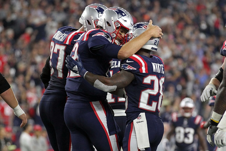 Oct 4, 2018; Foxborough, MA: New England Patriots quarterback Tom Brady celebrates a touchdown by running back James White during the second quarter against the Indianapolis Colts at Gillette Stadium. (Stew Milne-USA TODAY Sports)