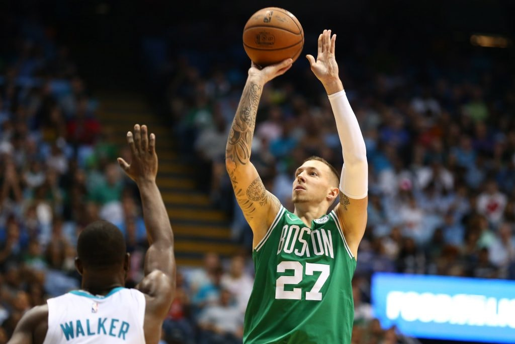 Celtics forward Daniel Theis (27) shoots the ball against Charlotte Hornets guard Kemba Walker (15) in the second half at Dean E. Smith Center. Mandatory Credit: Jeremy Brevard-USA TODAY Sports