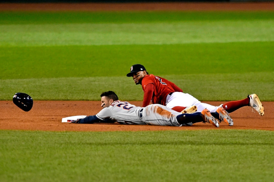 Oct 13, 2018; Boston, MA, USA; Houston Astros second baseman Jose Altuve (27) slides into second base against Boston Red Sox shortstop Xander Bogaerts (2) during the first inning in game one of the 2018 ALCS playoff baseball series at Fenway Park. Mandatory Credit: Brian Fluharty-USA TODAY Sports