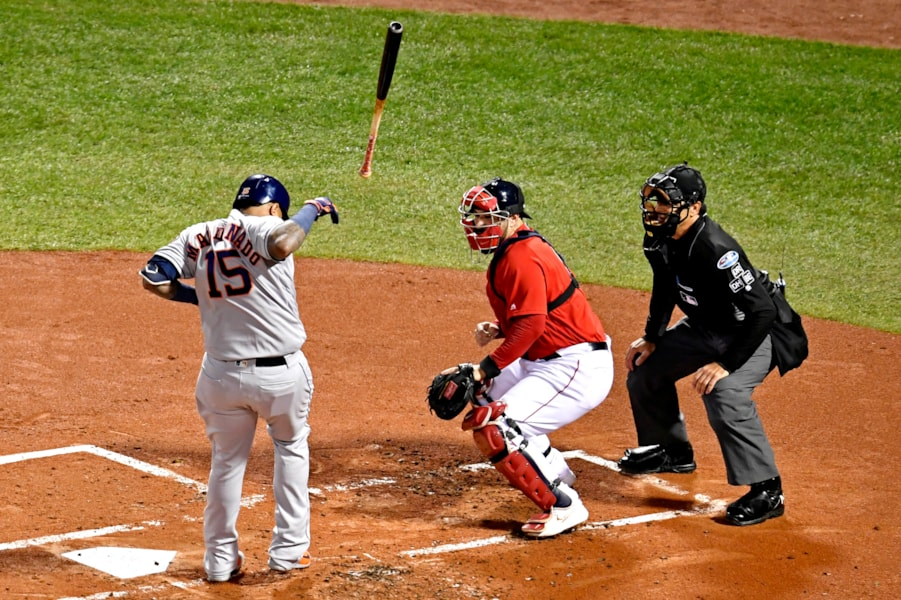 Oct 13, 2018; Boston, MA, USA; Houston Astros catcher Martin Maldonado (15) is hit by a pitch during the second inning against the Boston Red Sox in game one of the 2018 ALCS playoff baseball series at Fenway Park. Mandatory Credit: Brian Fluharty-USA TODAY Sports