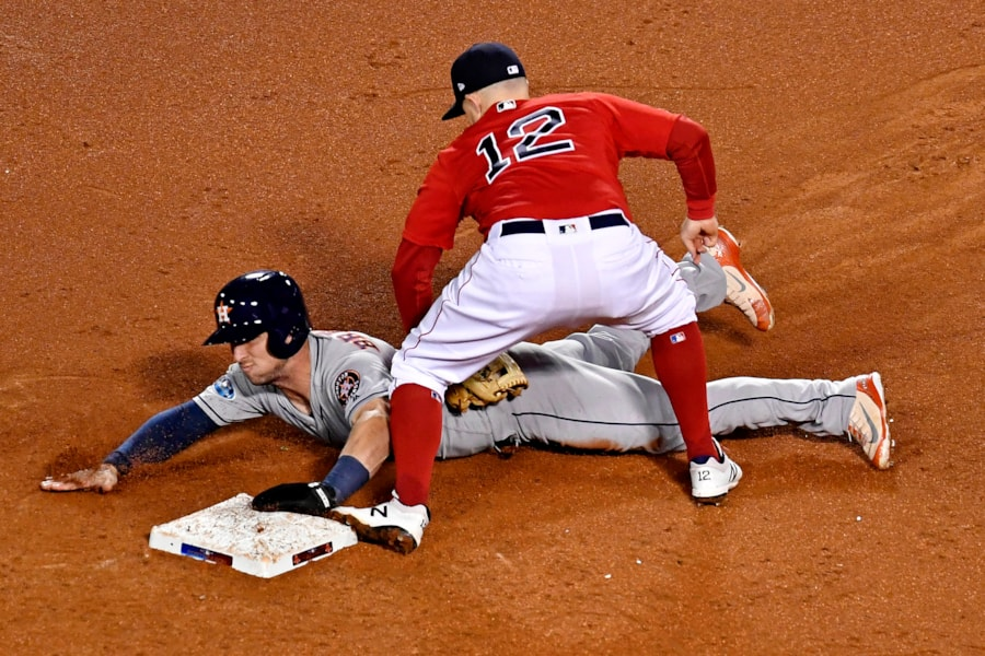 Oct 13, 2018; Boston, MA, USA; Houston Astros third baseman Alex Bregman (2) is tagged by Boston Red Sox second baseman Brock Holt (12) while trying to steal second base during the third inning in game one of the 2018 ALCS playoff baseball series at Fenway Park. Mandatory Credit: Brian Fluharty-USA TODAY Sports