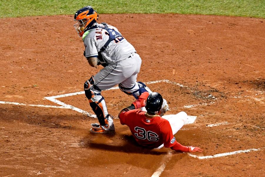 Oct 13, 2018; Boston, MA, USA; Boston Red Sox third baseman Eduardo Nunez (36) scores a run against Houston Astros catcher Martin Maldonado (15)  in game one of the 2018 ALCS playoff baseball series at Fenway Park. Mandatory Credit: Brian Fluharty-USA TODAY Sports