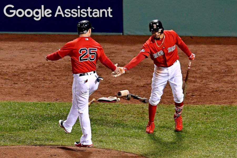 Oct 13, 2018; Boston, MA, USA; Boston Red Sox left fielder Steve Pearce (25) celebrates with right fielder Mookie Betts (50) after scoring a run during the fifth inning against the Houston Astros   in game one of the 2018 ALCS playoff baseball series at Fenway Park. Mandatory Credit: Brian Fluharty-USA TODAY Sports
