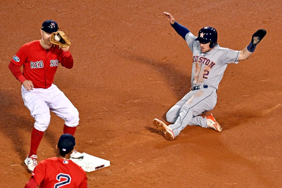 Oct 13, 2018; Boston, MA, USA; Houston Astros third baseman Alex Bregman (2) is forced out at second base by Boston Red Sox second baseman Brock Holt (12) during the seventh inning in game one of the 2018 ALCS playoff baseball series at Fenway Park. Mandatory Credit: Brian Fluharty-USA TODAY Sports