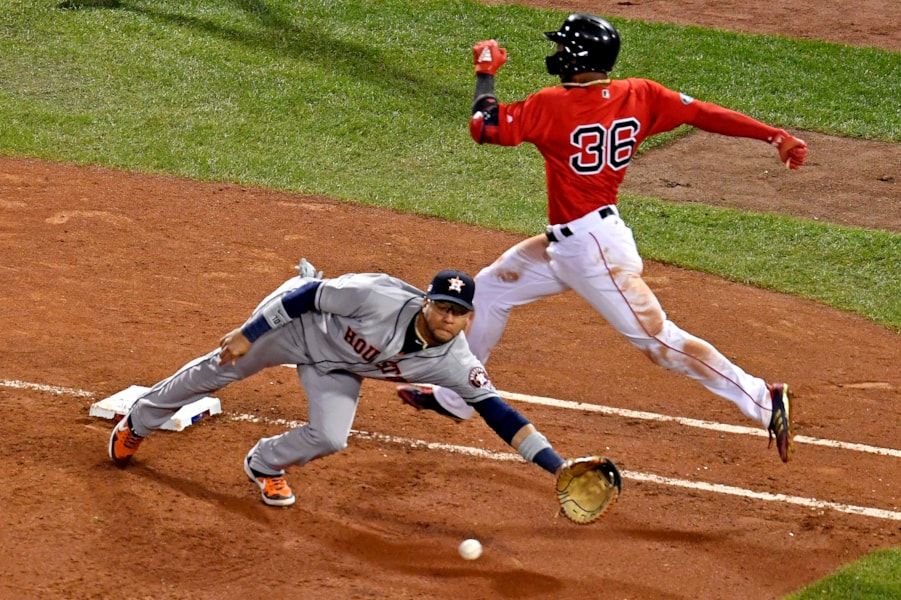 Oct 13, 2018; Boston, MA, USA; Houston Astros first baseman Yuli Gurriel (10) can not reach a throwing error by Houston Astros shortstop Carlos Correa (not pictured) as Boston Red Sox third baseman Eduardo Nunez (36) reaches first base during the seventh inning in game one of the 2018 ALCS playoff baseball series at Fenway Park. Mandatory Credit: Brian Fluharty-USA TODAY Sports