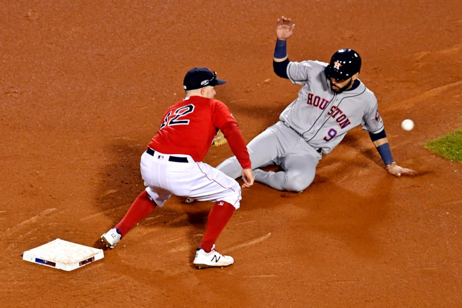 Oct 13, 2018; Boston, MA, USA; Houston Astros left fielder Marwin Gonzalez (9) is caught steal second base by Boston Red Sox second baseman Brock Holt (12) during the ninth inning in game one of the 2018 ALCS playoff baseball series at Fenway Park. Mandatory Credit: Brian Fluharty-USA TODAY Sports