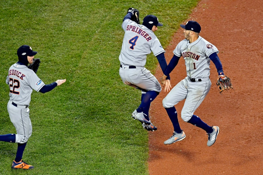 Oct 13, 2018; Boston, MA, USA; Houston Astros center fielder George Springer (4) and shortstop Carlos Correa (1) celebrate after beating the Boston Red Sox in game one of the 2018 ALCS playoff baseball series at Fenway Park. Mandatory Credit: Brian Fluharty-USA TODAY Sports