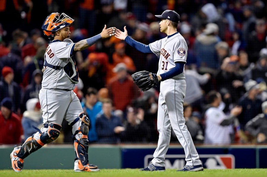Oct 13, 2018; Boston, MA, USA; Houston Astros relief pitcher Collin McHugh (31) and catcher Martin Maldonado (15) celebrate after beating the Boston Red Sox in game one of the 2018 ALCS playoff baseball series at Fenway Park. Mandatory Credit: Bob DeChiara-USA TODAY Sports