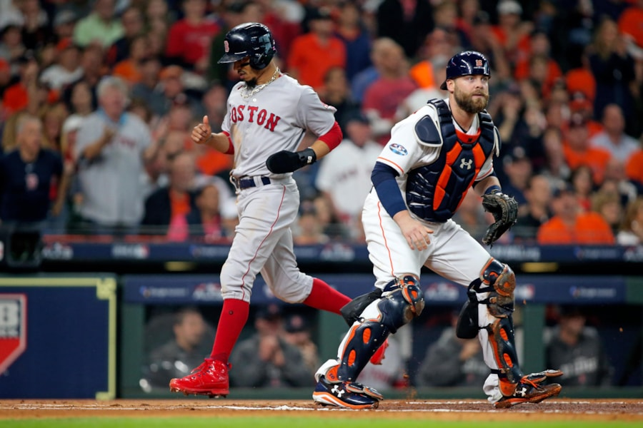 Oct 16, 2018; Houston, TX, USA; Boston Red Sox right fielder Mookie Betts (50) scores a run in the first inning against the Houston Astros in game three of the 2018 ALCS playoff baseball series at Minute Maid Park. Mandatory Credit: Troy Taormina-USA TODAY Sports