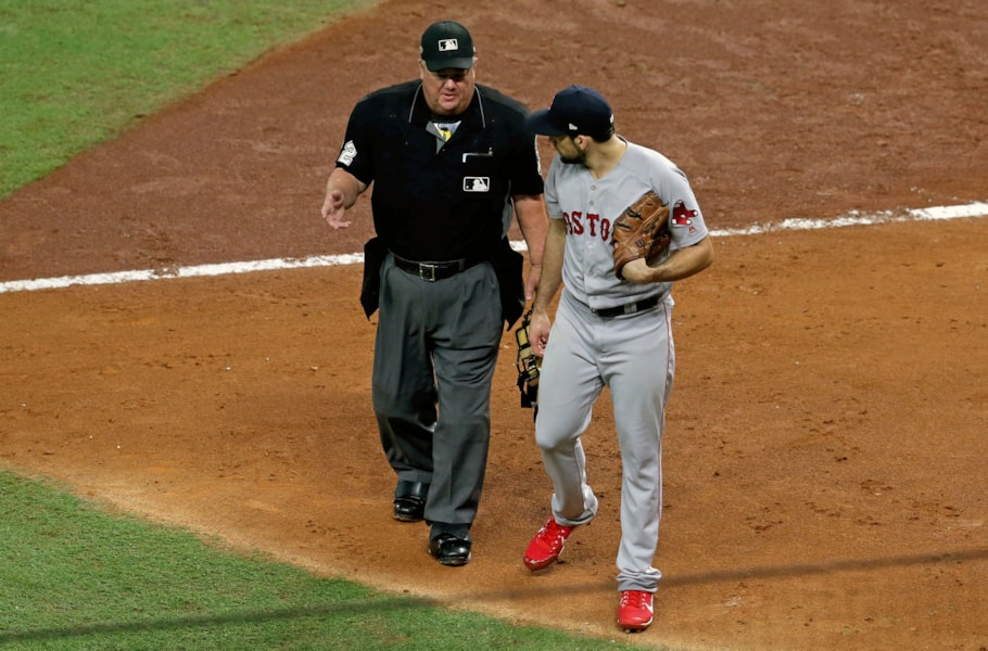 Oct 16, 2018; Houston, TX, USA; Boston Red Sox starting pitcher Nathan Eovaldi (17) talks with Home Plate umpire Joe West (22) after the second inning in game three of the 2018 ALCS playoff baseball series against the Houston Astros at Minute Maid Park. Mandatory Credit: Thomas B. Shea-USA TODAY Sports
