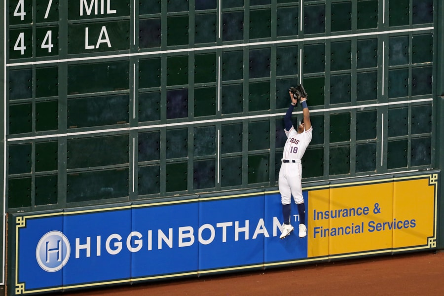 Oct 16, 2018; Houston, TX, USA; Houston Astros left fielder Tony Kemp (18) makes a catch against the wall in the third inning against the Boston Red Sox in game three of the 2018 ALCS playoff baseball series at Minute Maid Park. Mandatory Credit: Thomas B. Shea-USA TODAY Sports
