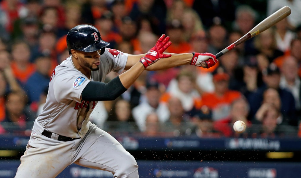 Oct 16, 2018; Houston, TX, USA; Boston Red Sox shortstop Xander Bogaerts (2) singles in the eighth inning against the Houston Astros in game three of the 2018 ALCS playoff baseball series at Minute Maid Park. Mandatory Credit: Troy Taormina-USA TODAY Sports