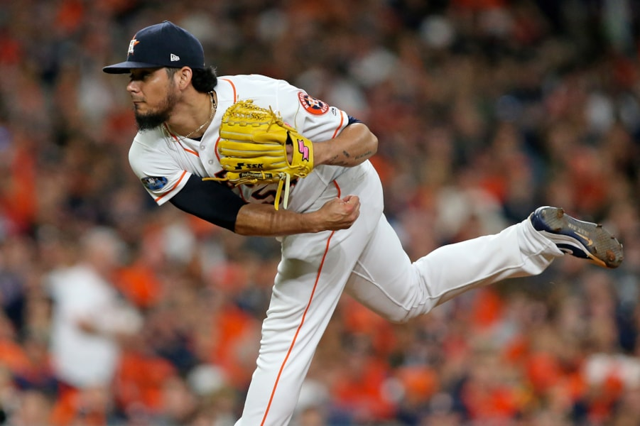 Oct 16, 2018; Houston, TX, USA; Houston Astros relief pitcher Roberto Osuna (54) delivers a pitch in the eighth inning against the Boston Red Sox in game three of the 2018 ALCS playoff baseball series at Minute Maid Park. Mandatory Credit: Troy Taormina-USA TODAY Sports