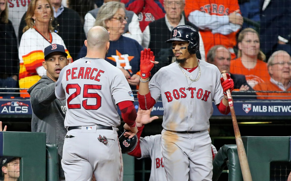 Oct 16, 2018; Houston, TX, USA; Boston Red Sox first baseman Steve Pearce (25) celebrates with manager Alex Cora (20) and Boston right fielder Mookie Betts (50) after scoring a run in the eighth inning against the Houston Astros in game three of the 2018 ALCS playoff baseball series at Minute Maid Park. Mandatory Credit: Troy Taormina-USA TODAY Sports