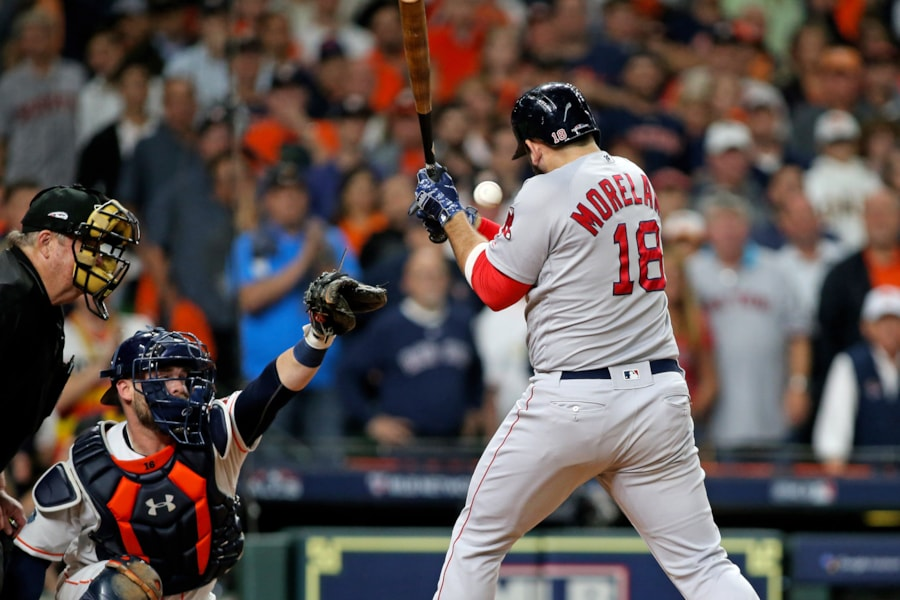 Oct 16, 2018; Houston, TX, USA; Boston Red Sox first baseman Mitch Moreland (18) is hot by a pitch that scores a run in the eighth inning against the Houston Astros in game three of the 2018 ALCS playoff baseball series at Minute Maid Park. Mandatory Credit: Troy Taormina-USA TODAY Sports