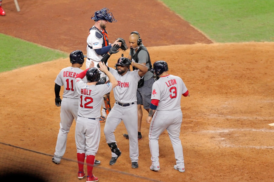 Oct 16, 2018; Houston, TX, USA; Boston Red Sox center fielder Jackie Bradley Jr. (19) celebrates with third baseman Rafael Devers (11), second baseman Brock Holt (12) and catcher Sandy Leon (3) after his grand slam home run in the eighth inning against the Houston Astros in game three of the 2018 ALCS playoff baseball series at Minute Maid Park. Mandatory Credit: Erik Williams-USA TODAY Sports
