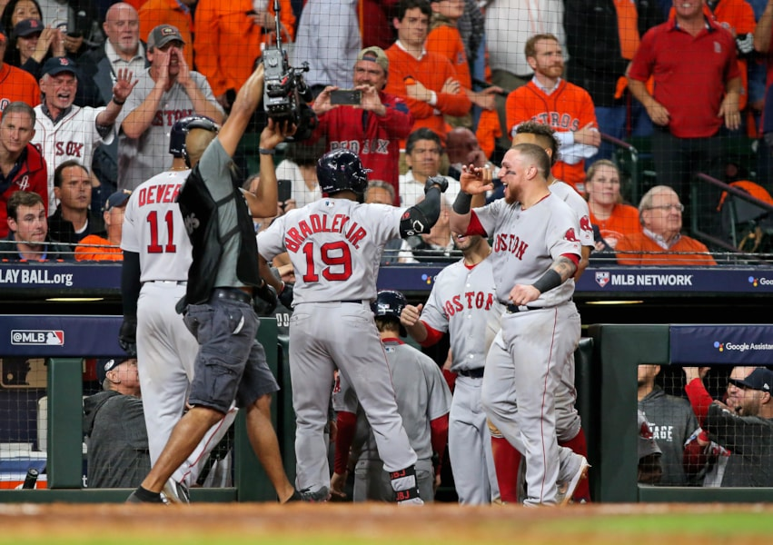 Oct 16, 2018; Houston, TX, USA; Boston Red Sox center fielder Jackie Bradley Jr. (19) celebrates his grand slam home run with teammates in the eighth inning of game three of the 2018 ALCS playoff baseball series against the Houston Astros at Minute Maid Park. Mandatory Credit: Troy Taormina-USA TODAY Sports