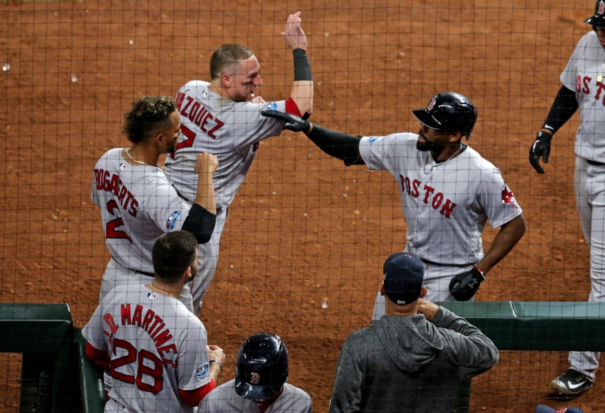 Oct 16, 2018; Houston, TX, USA; Boston Red Sox center fielder Jackie Bradley Jr. (19) celebrates his grand slam home run with teammates in the eighth inning of game three of the 2018 ALCS playoff baseball series against the Houston Astros at Minute Maid Park. Mandatory Credit: Thomas B. Shea-USA TODAY Sports