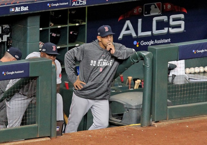 Oct 16, 2018; Houston, TX, USA; Boston Red Sox manager Alex Cora (20) watches from the dugout in the ninth inning against the Houston Astros in game three of the 2018 ALCS playoff baseball series at Minute Maid Park. Mandatory Credit: Erik Williams-USA TODAY Sports